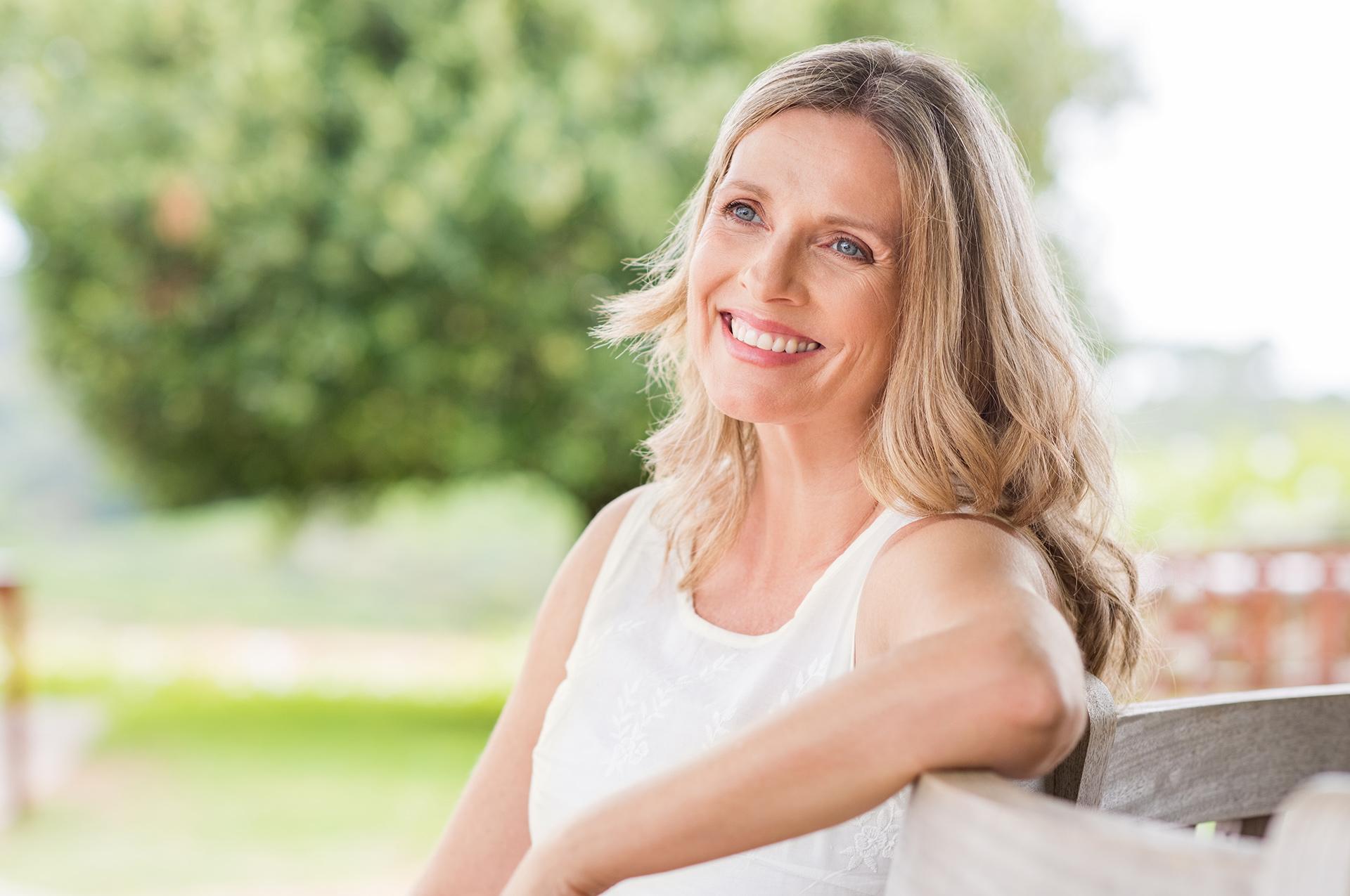 Outdoor portrait positive confident mature woman stock photo